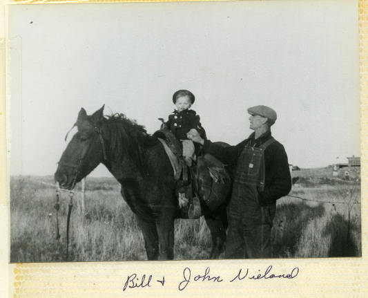 Bill and John Nieland with a horse