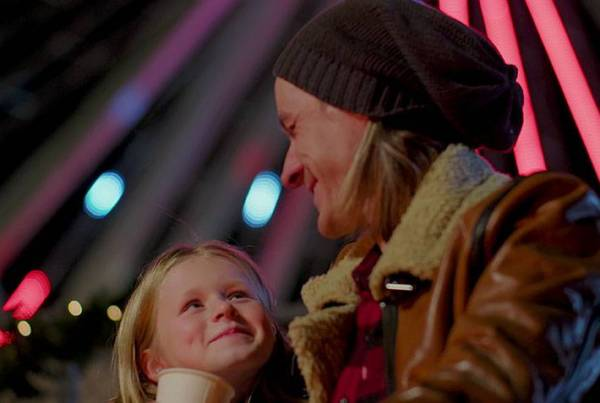 Father and daugher enjoing hot chocolate and a happy winter evening at the Branson Ferris Wheel.