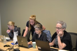 Brooke Stewart, one of our Pitt-Greensburg student coders, moves to assist participants.