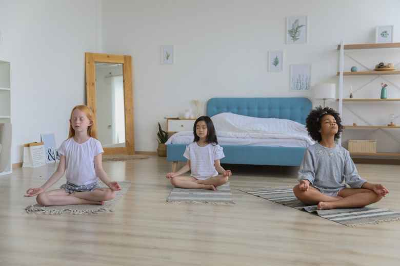 focused multiracial friends meditating in room