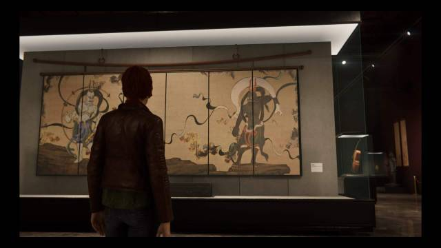 Screenshot from Spider-Man (PS4) documenting a stage set in a museum gallery.