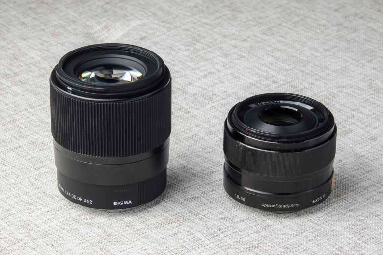 Sigma 30mm f/1.4 on the left, Sony 35mm f/1.8 OSS on the right