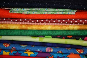 The beginning! Selection of bright fabrics for the Wonky Puzzle Blocks Baby Quilt.