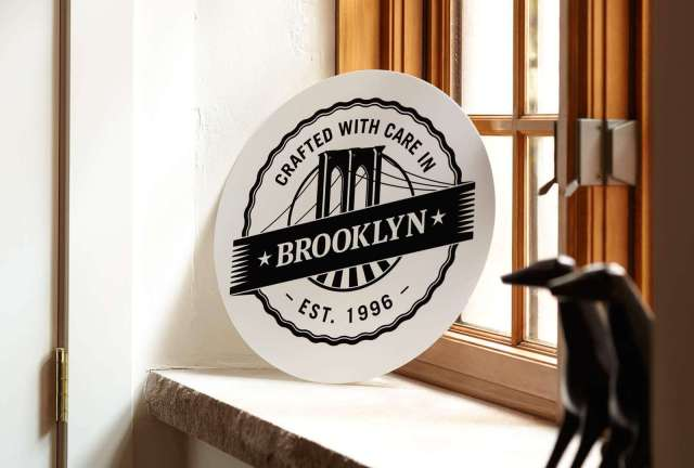 Created In Brooklyn By AdoramaPix badge in the corner of the room near a window