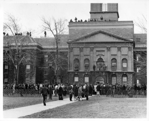 Academic building on UB South Campus; crowd of young people in front, apparently protesting the Vietnam War.