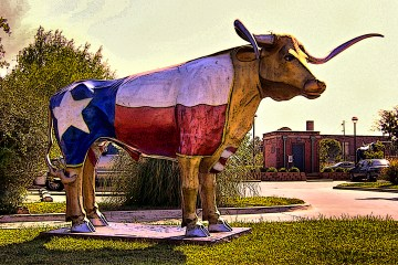 Sculpture of a very large Texas longhorn with the Texas flag painted on its body