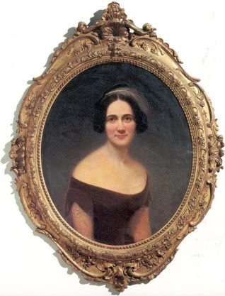 A small painted portrait of a woman in a baroque frame