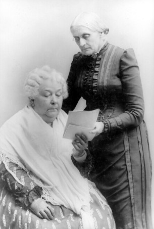 Elizabeth Cady Stanton and Susan B. Anthony - a black and white photograph of two older white women reading a letter together