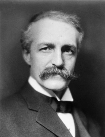 A black and white photograph of a white man