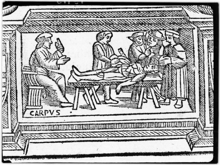 A woodcut depicting several men standing around a dead body being cut up on a wooden table