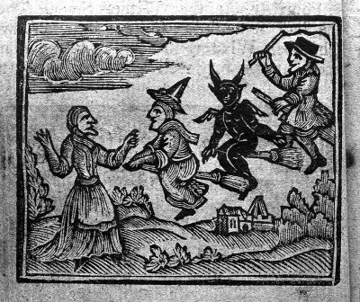 A woodcut depicting a male and female witch riding brooms with a black demon