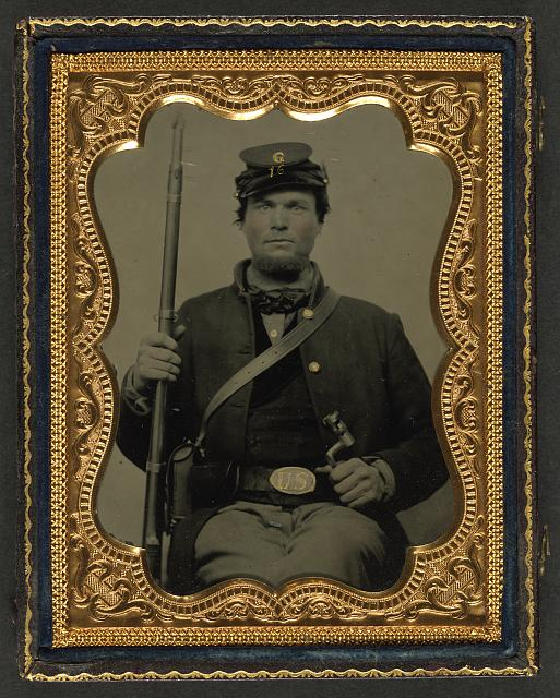 Union soldier carrying a rifle and holding a bayonet