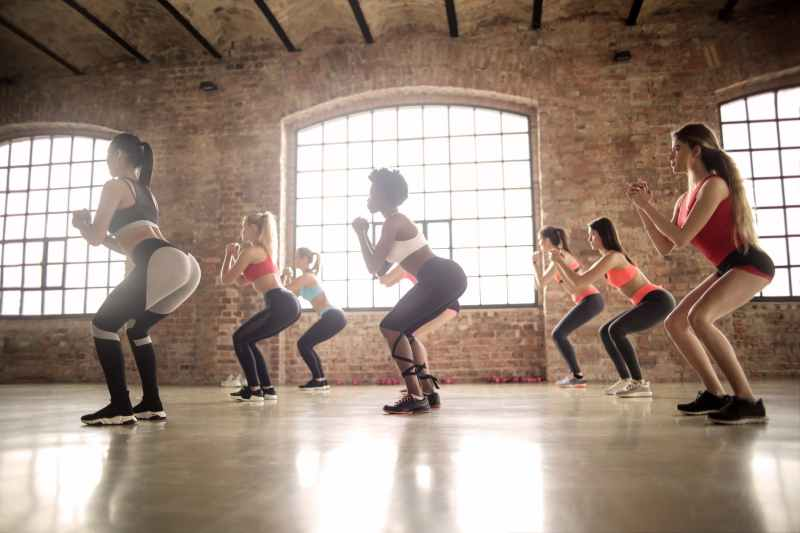 group of women doing exercise inside the building