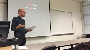 Photograph of Andrew Dilts, presenting a lecture at Rowan University, Feb. 2017