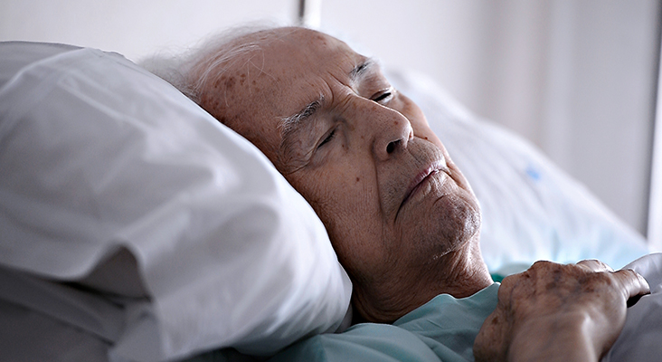 Old man sleeping in a hospital