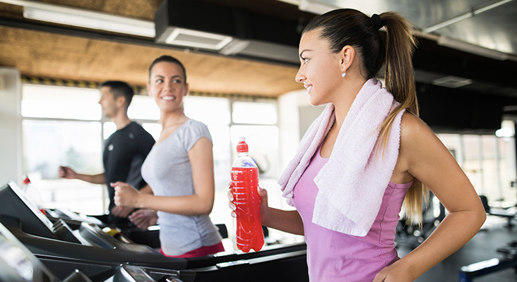 woman on treadmill with sports drink