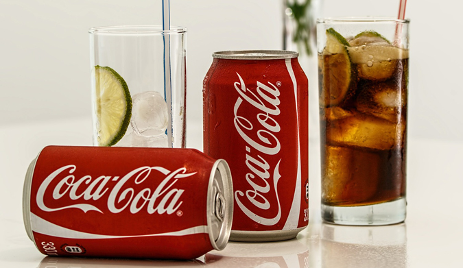 Ποιος πραγματικά ανακάλυψε Coca Cola;