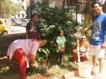 Manisha shaw is planting a flower plant