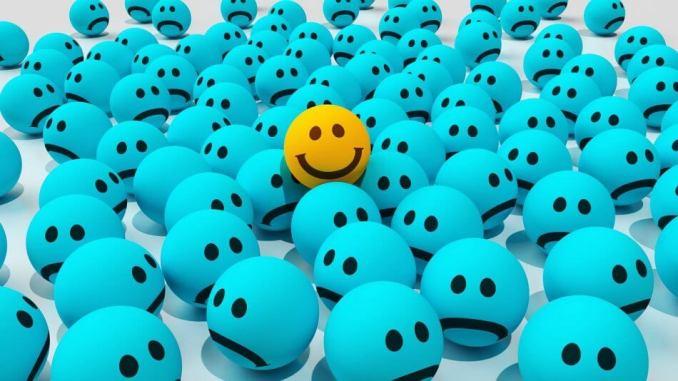 gambar emot smile di tengah tengah emot murung