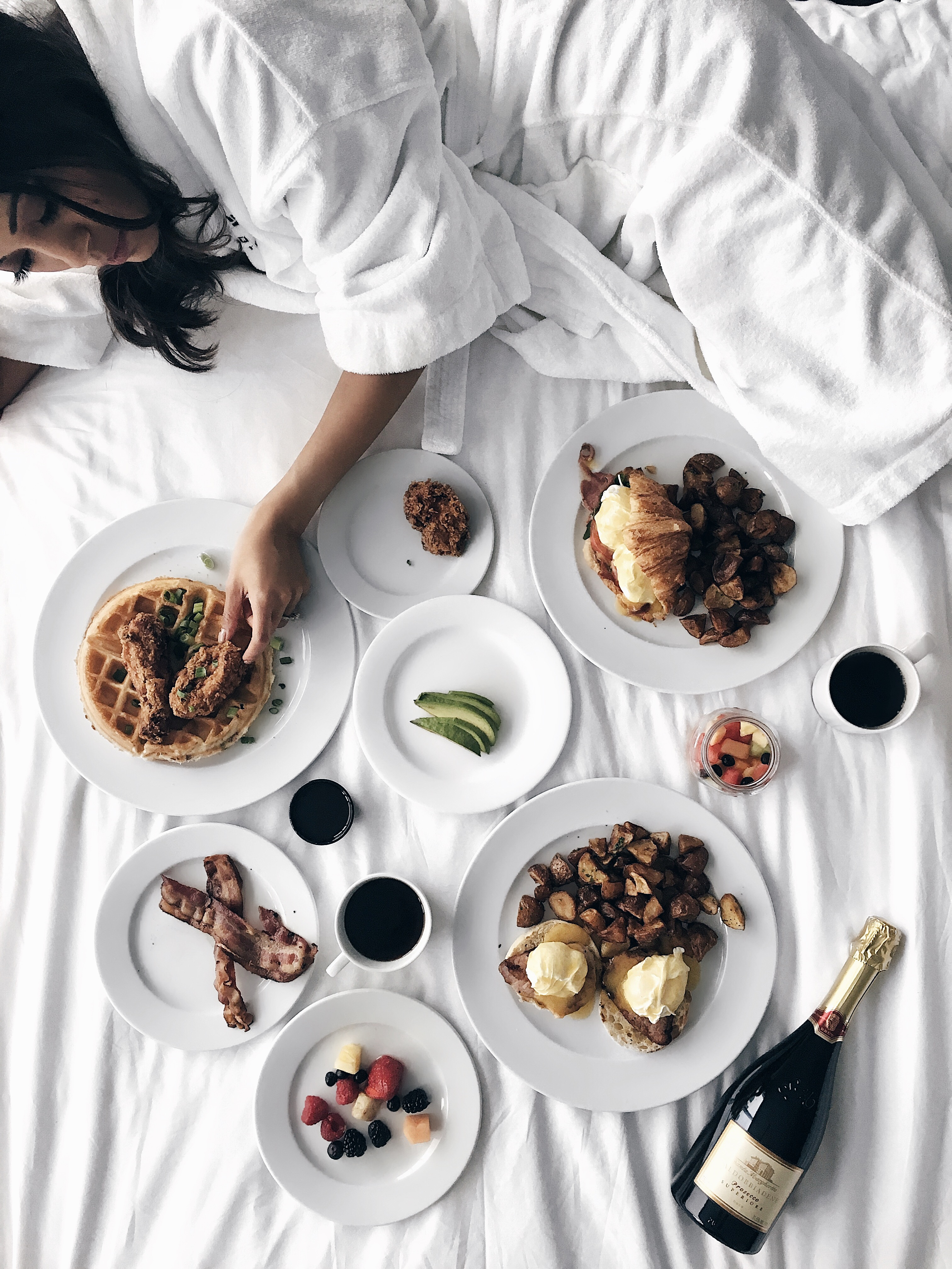 Enjoying brunch in bed at the Thompson Toronto