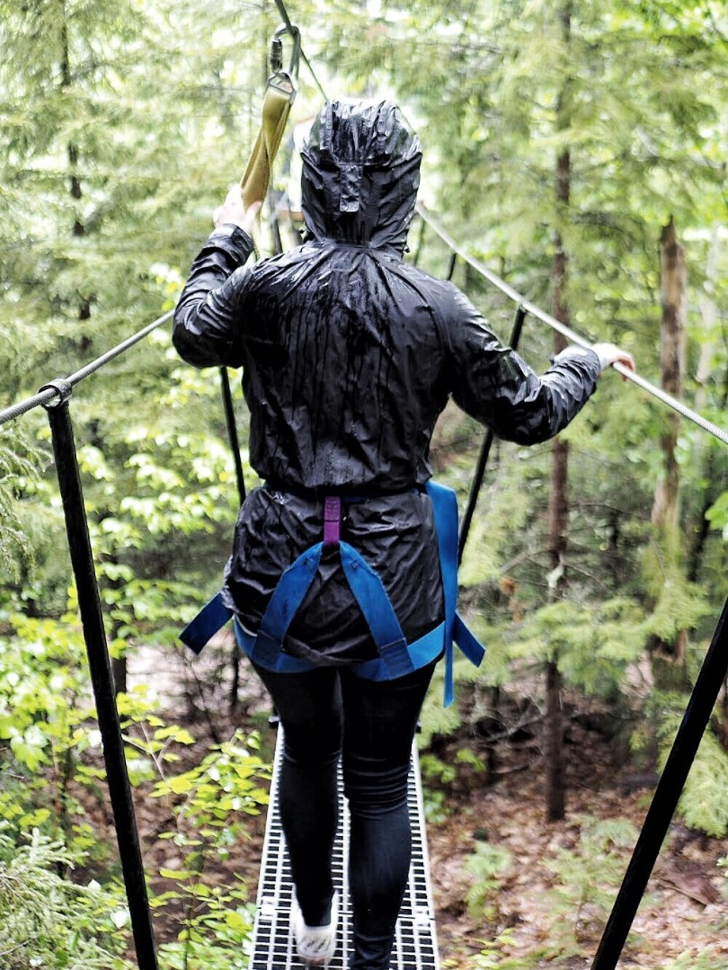 Jeanne walking along a canopy in the White Mountains