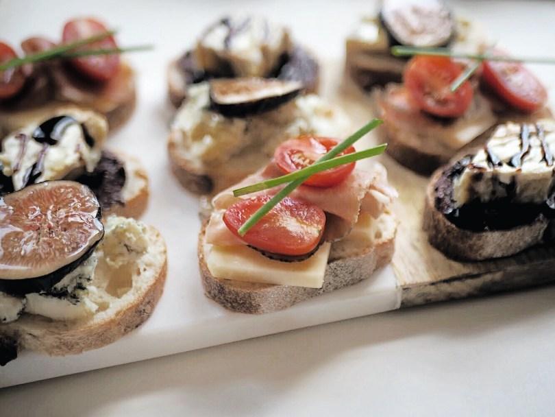 Prosciutto, Avonlea cheddar, cherry tomato and chive crostini