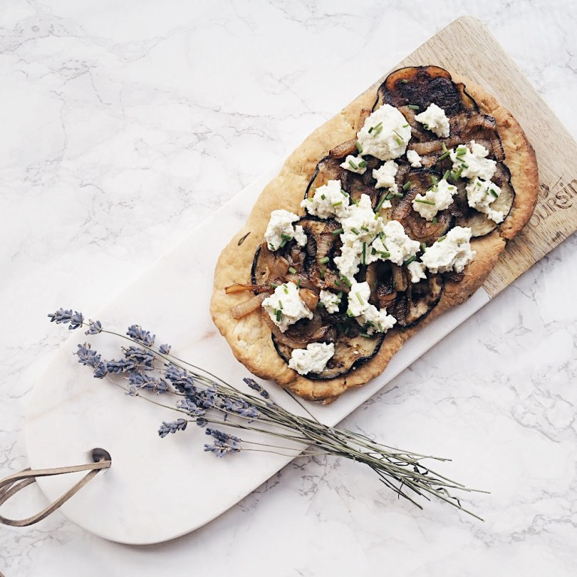 Italian flatbread presented on a marble board with lavender