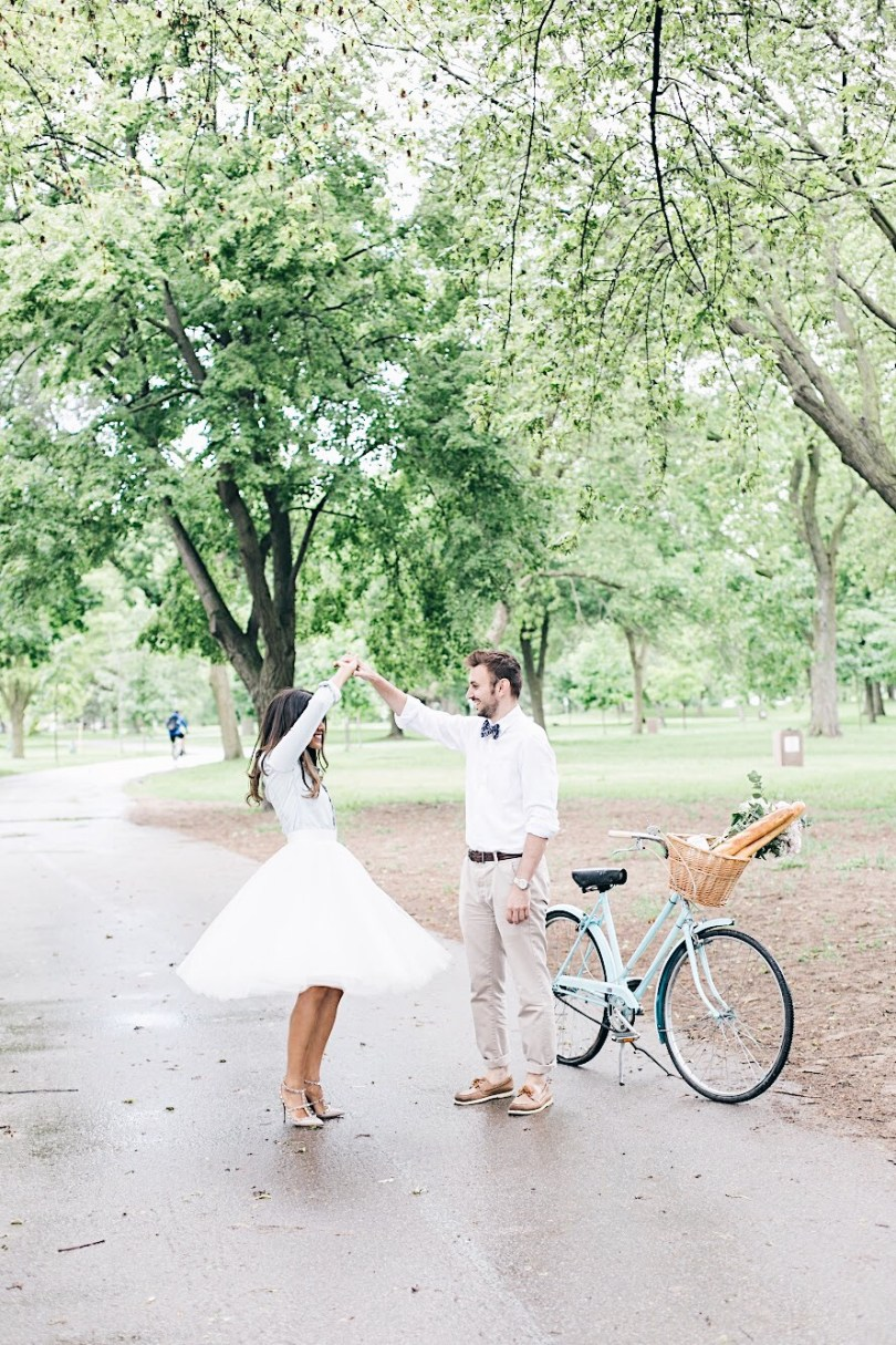 Twirling in the park wearing tulle skirt with cute bike with basket