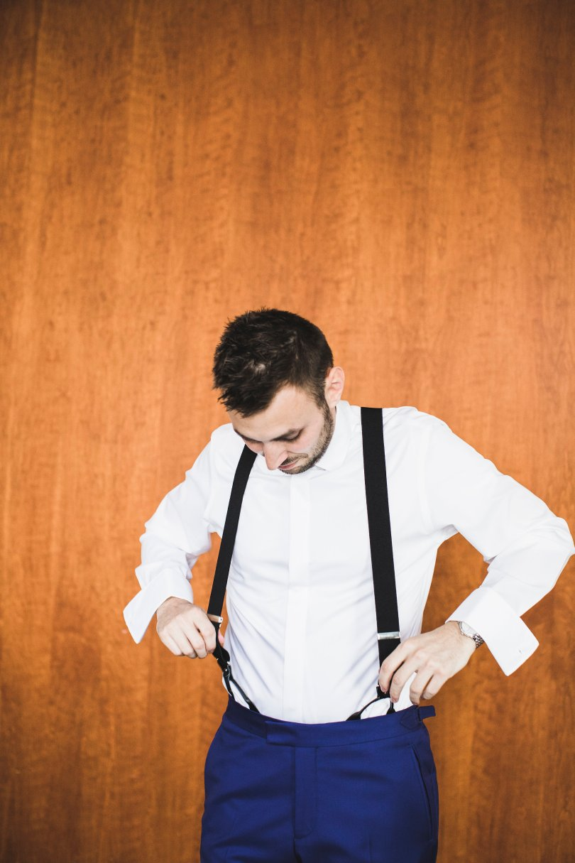 Alex getting his suspenders on