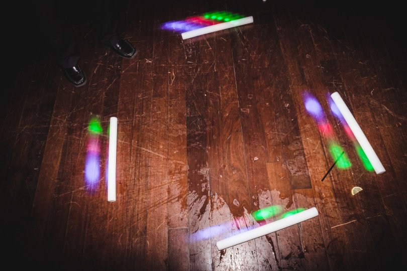 Glowsticks on the ground at the end of the night