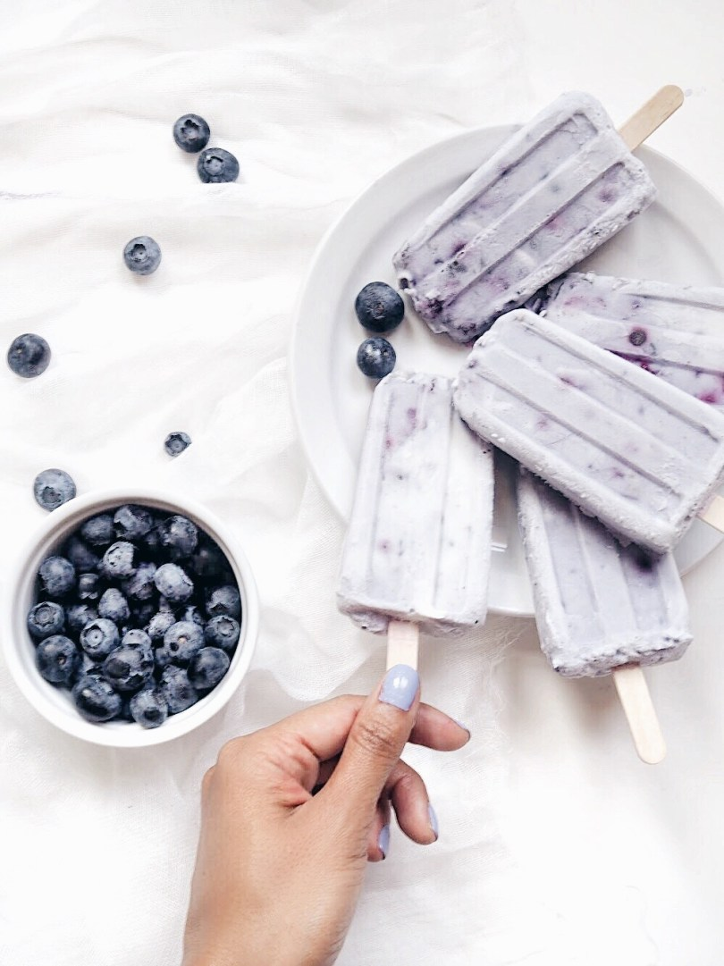 Me grabbing one of these delicious coconut blueberry popsicles