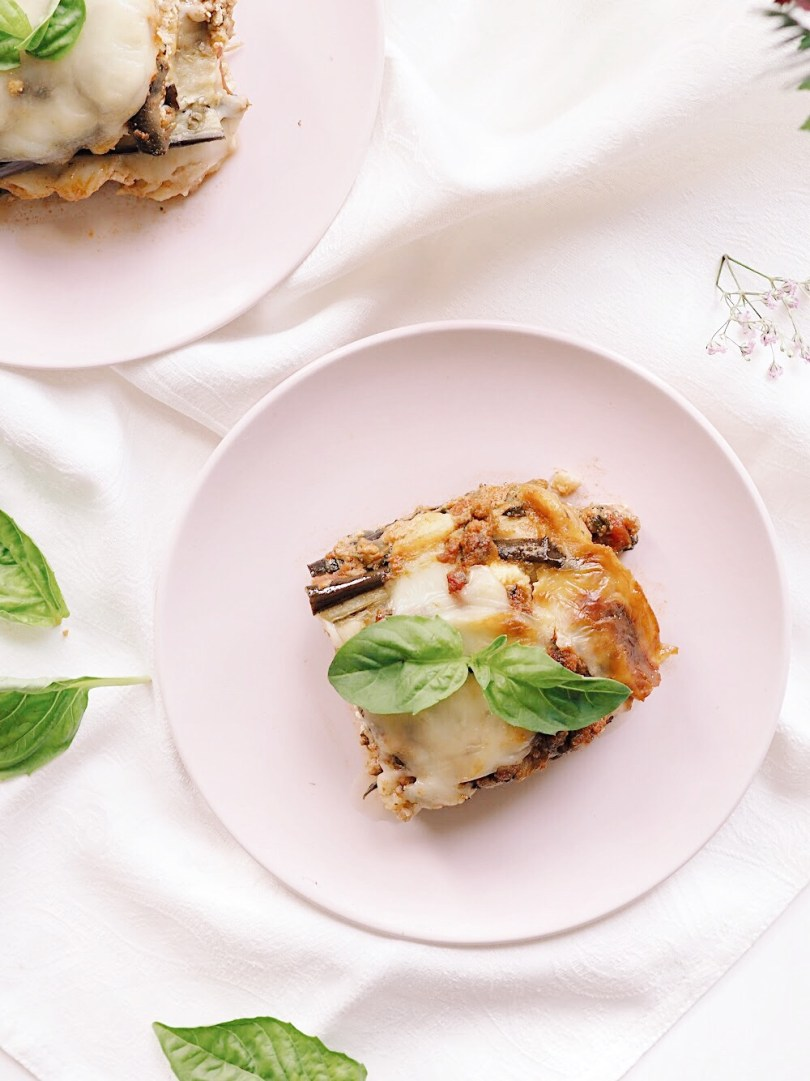 Slice of eggplant lasagna with basil on top