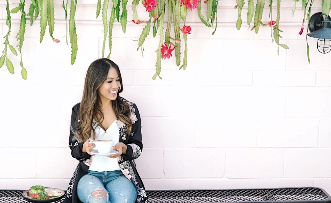 Me laughing while holding coffee