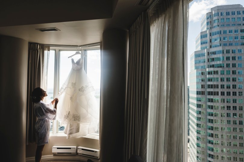 wedding dress hung in window