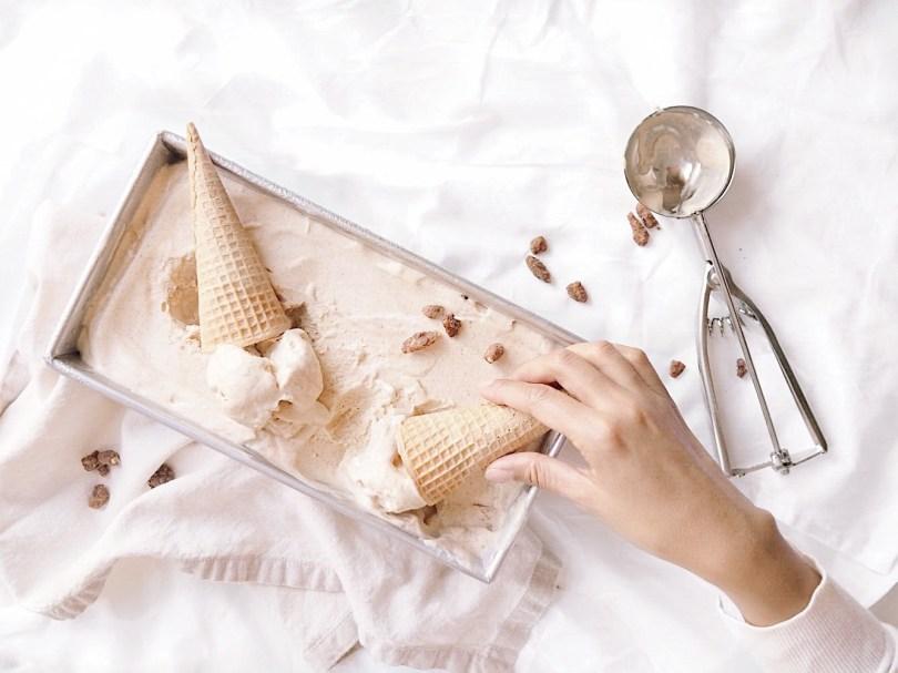 Grabbing cone of no-churn ice cream