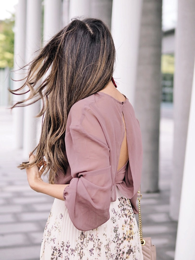 Slit at the back of this sheer chiffon blouse and bodysuit