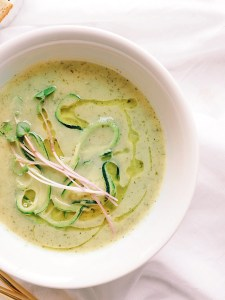 Zucchini, leek and basil soup garnished with micro-greens