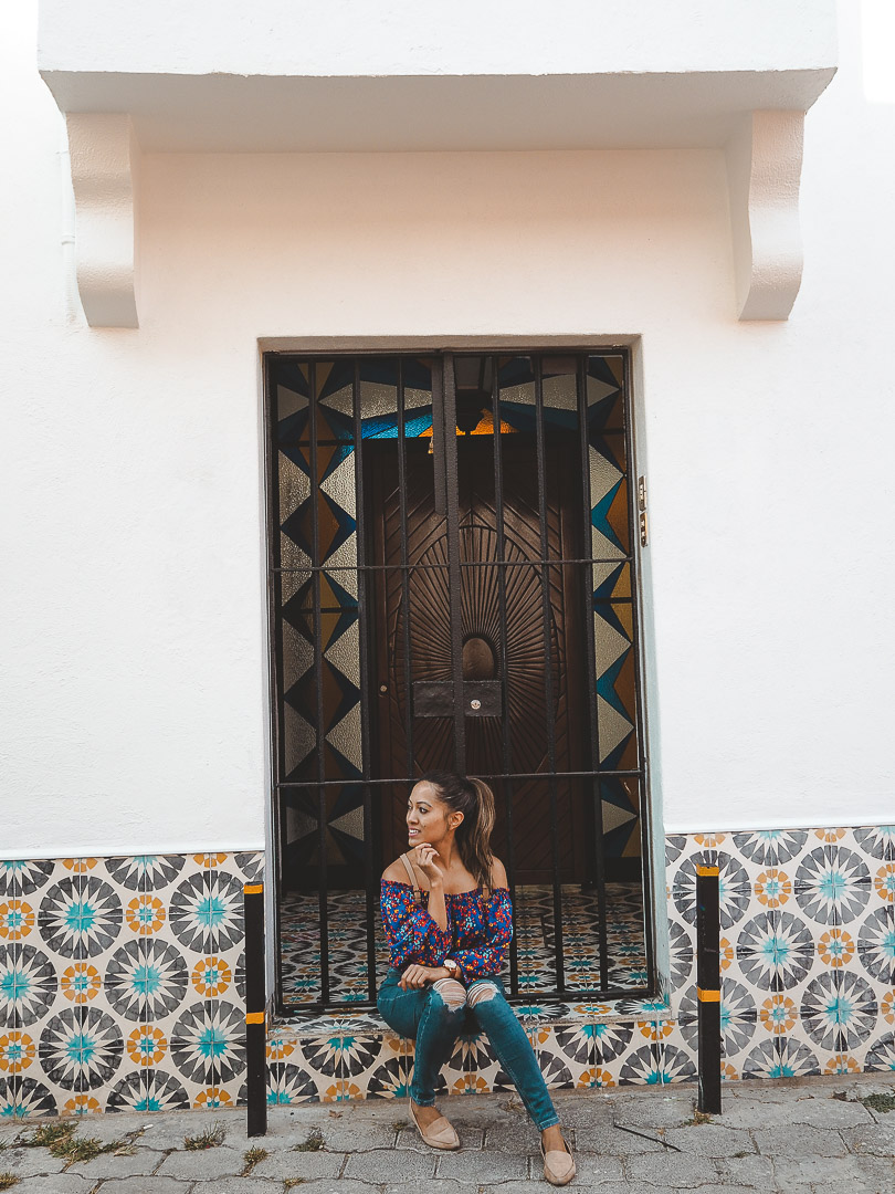 Sitting in front of tiled house in Coyoacan