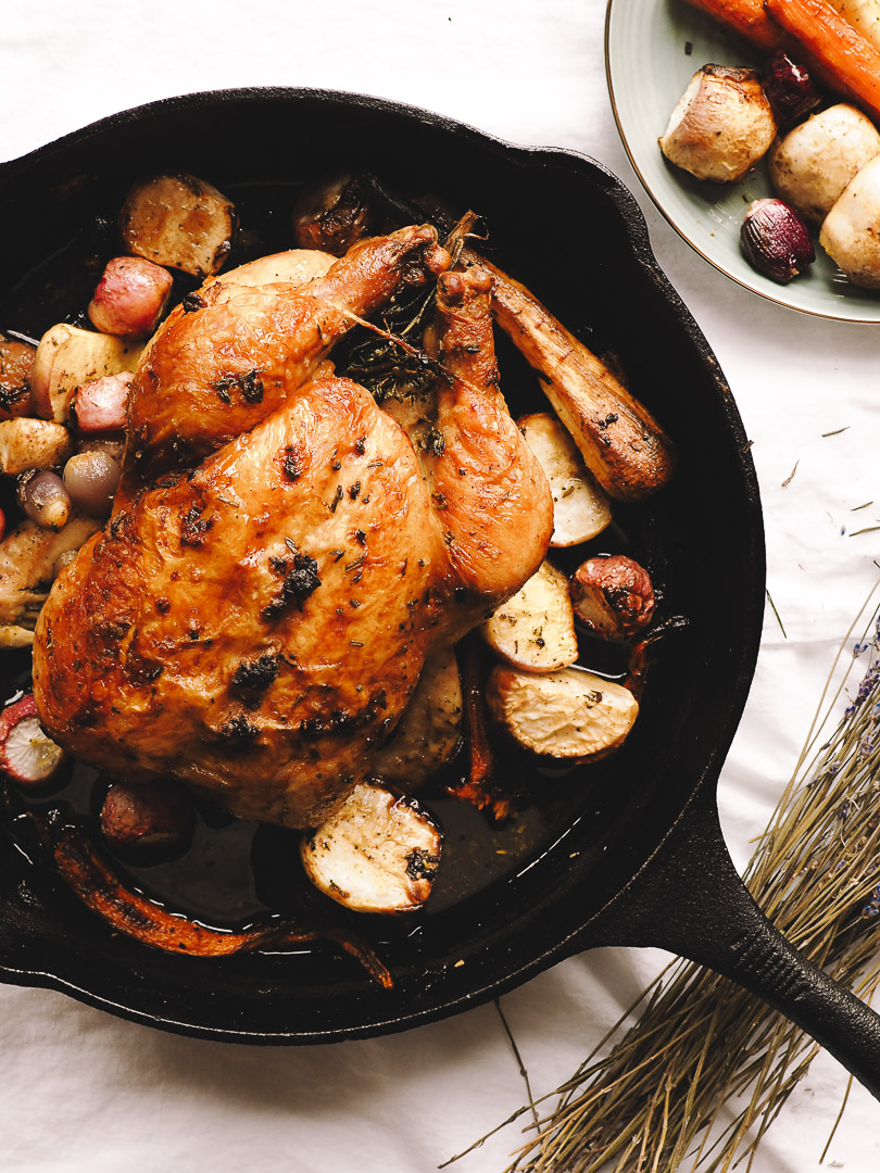 Root vegetables in skillet with chicken