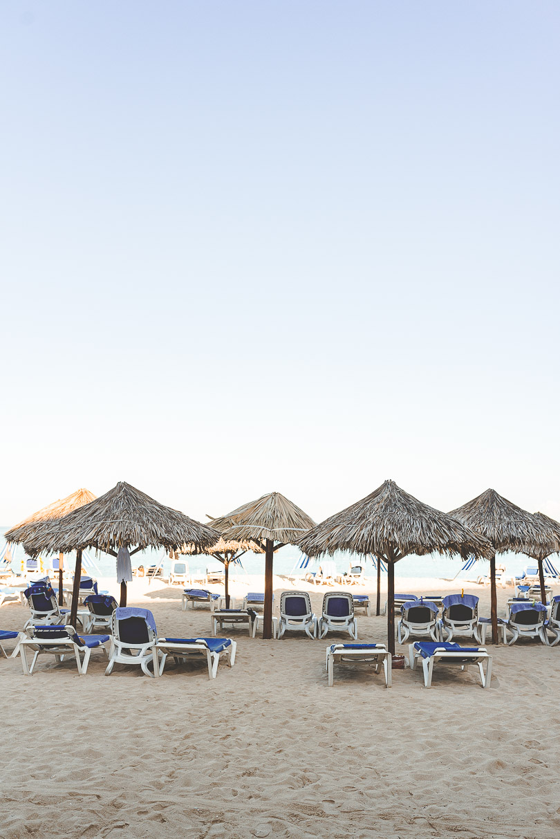 View of beach chairs and umbrellas on the beach at Royal Decameron Cornwall Beach