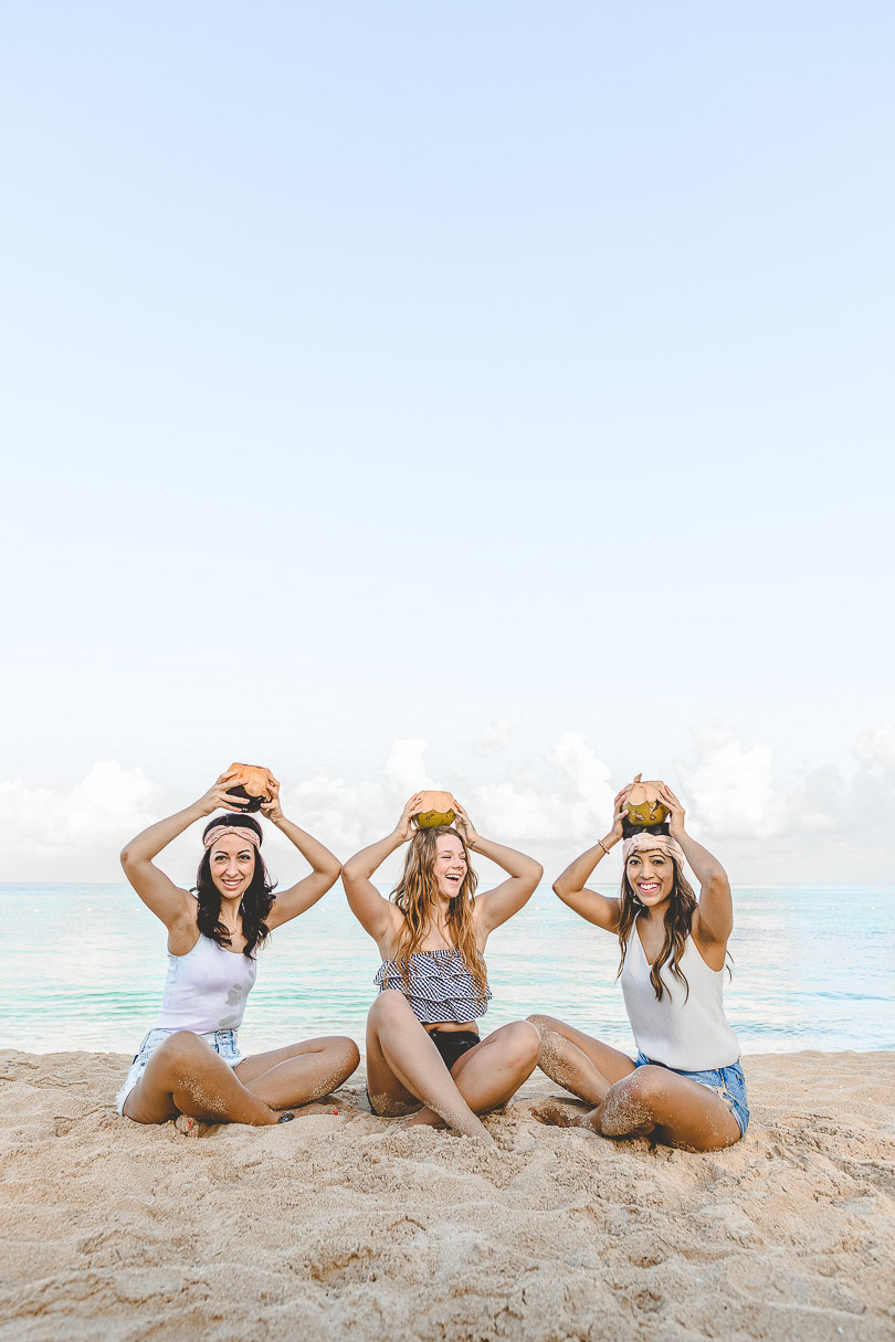 Sitting with coconuts on top of our heads on the beach