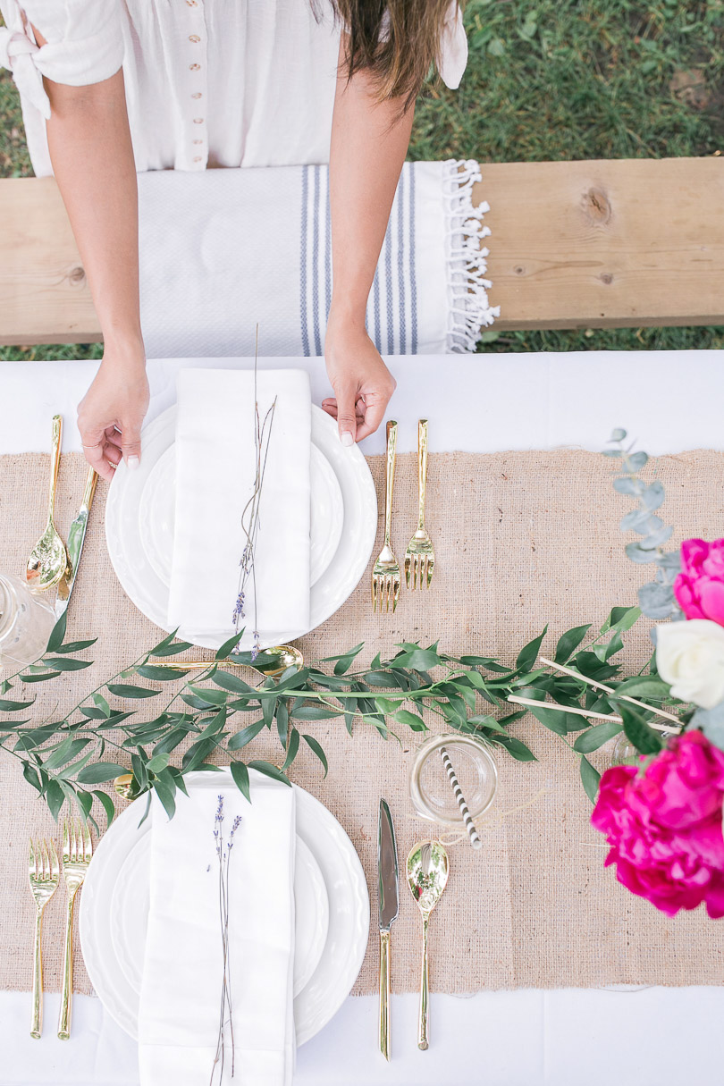 Setting the table for elegant picnic in the park