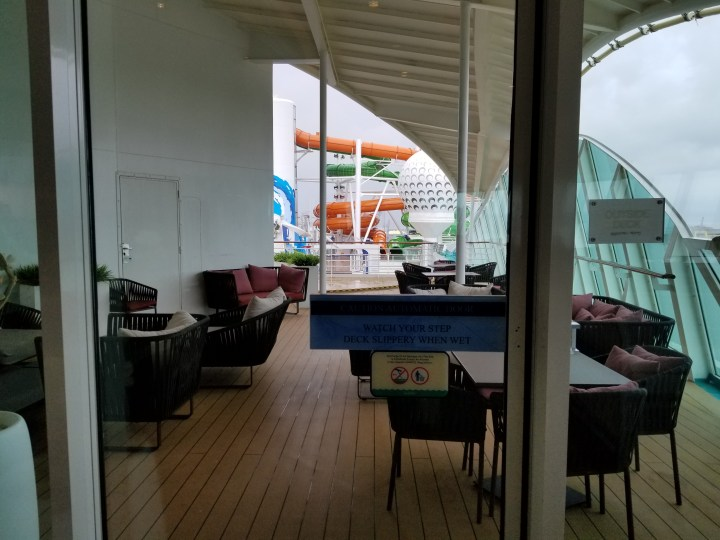Outdoor seating in the Suite Lounge on the Liberty of the Seas.