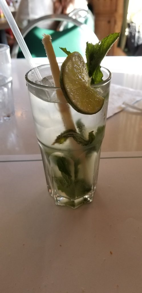 My Cuban mojito at Versailles. I appreciate the piece of sugar cane to use as a swizzle stick.