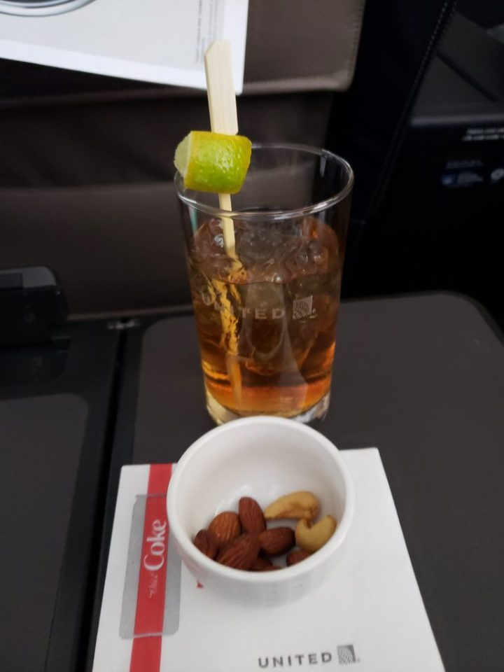 Nuts and a drink start United first class meals.