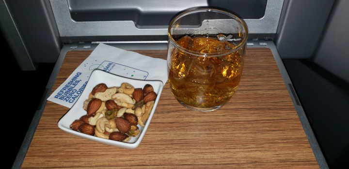 Like all first class passengers, those who order the American Airlines Muslim meal get nuts and a drink of their choosing.