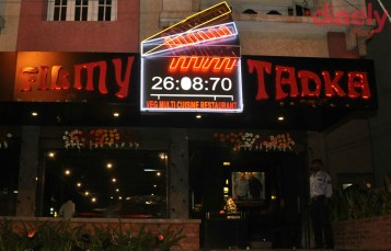 Filmy Tadka Theme: Movie Theme A tiny, cozy and totally filmy restaurant in Shivam Road. The huge clapboard at the entrance creates such curiosity that can't resist but walk in. The entire place is filled with film props and posters. All the while you will be listening to super hit movie songs from different languages. Ever wonder what would it be like sitting in a director's chair? You can fulfill it here because that is where you'll be sitting. The menu is also designed very interestingly with all blockbuster movie posters on a side. It is a pure vegetarian restro. Their food is lip-smacking for sure and adding to it, you can call the chef out, tell him your favorite ingredients and he'll come up with an interesting dish just for you. Amazing, isn't it? Address: Opposite to Reliance Fresh, Shivam Road, Amberpet, Hyderabad.