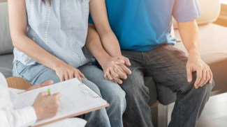 Couple consulting with doctor about STDs
