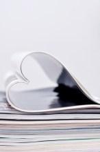 magazine folded into a heart shape