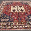 Geometric handmade rug with lion icons